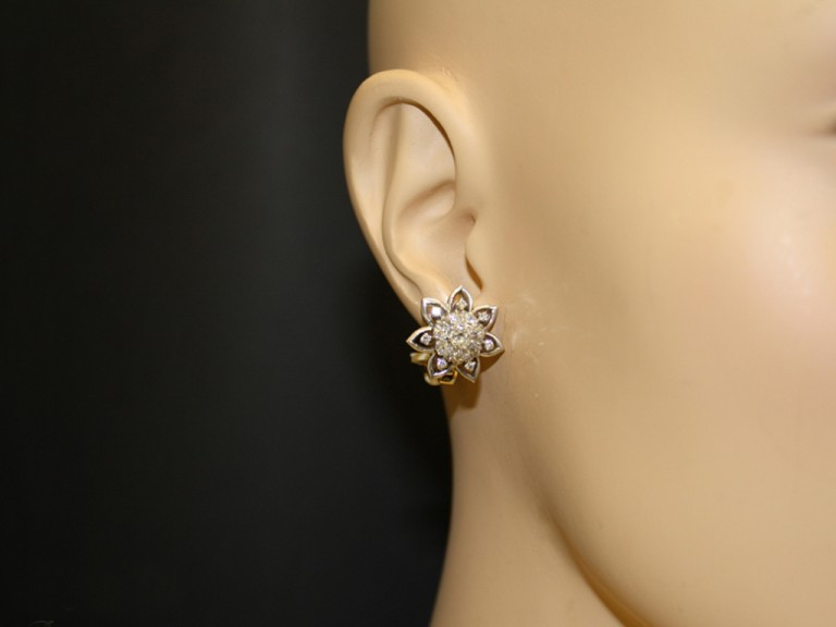 Vintage diamond cluster clip earrings, circa 1950.