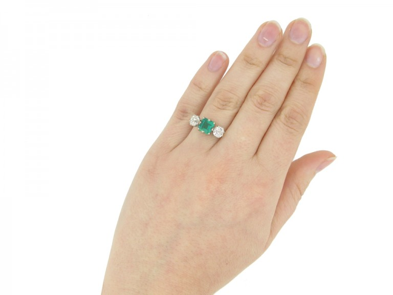 hand view Antique Colombian emerald and diamond three stone ring, circa 1910.