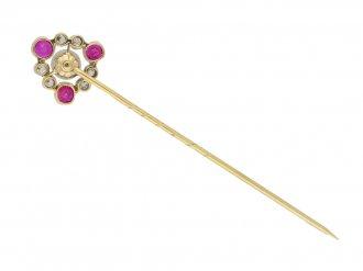 Antique natural pearl, ruby and diamond pin, circa 1905.