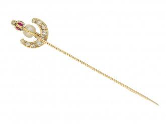 Antique natural pearl, ruby and diamond pin, circa 1900.