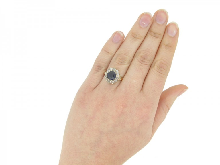 hand view Antique sapphire diamond cluster ring, circa 1905.