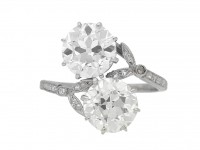 front view Antique diamond two stone cross over engagement ring, circa 1915.