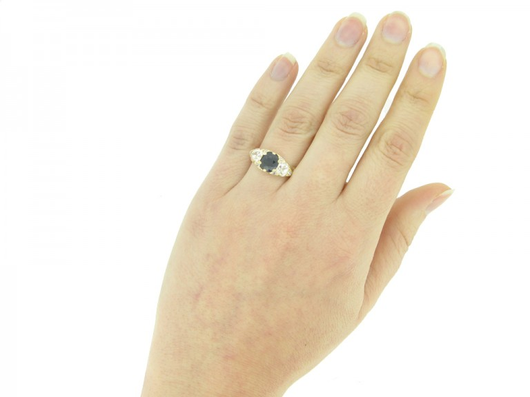 hand view Antique sapphire and diamond three stone ring, circa 1900.
