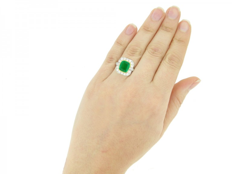 hand vie3w Colombian emerald and diamond cluster ring, circa 1940.