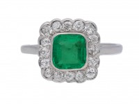 front view Antique emerald and diamond cluster ring, circa 1915.