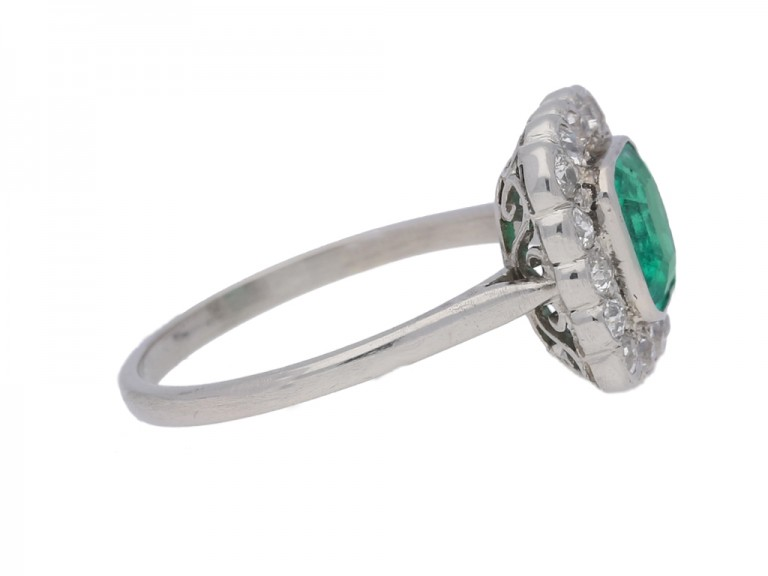 side view Antique emerald and diamond cluster ring, circa 1915.
