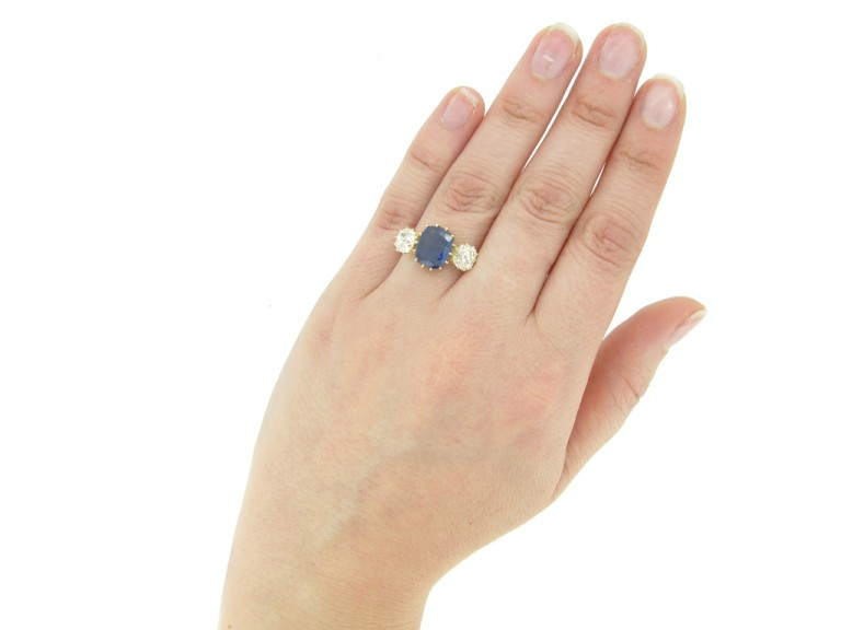hand view Antique sapphire and diamond three stone engagement ring, circa 1900.