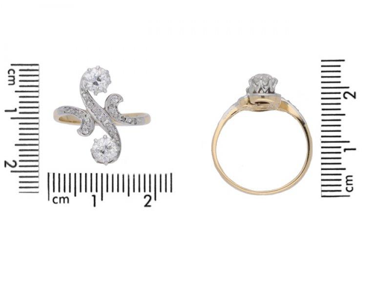 size view Art Nouveau diamond two stone cross over ring, circa 1905.