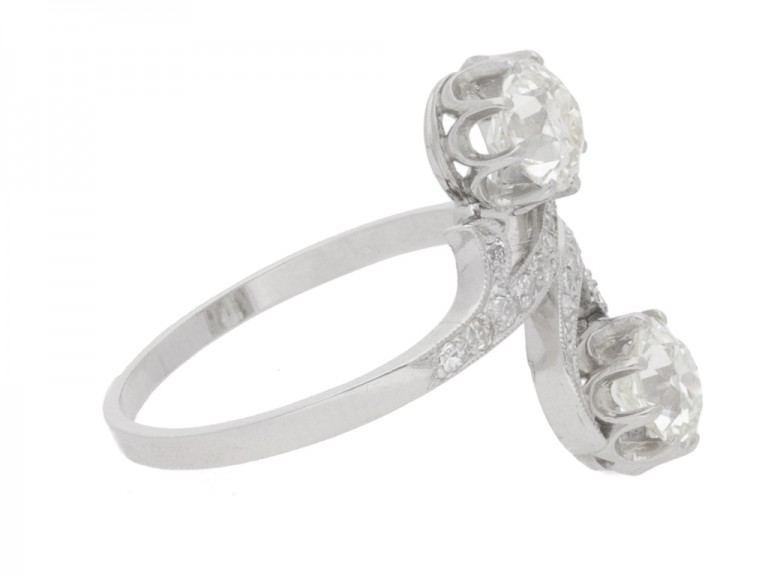 side view Antique diamond two stone cross over engagement ring, circa 1910.