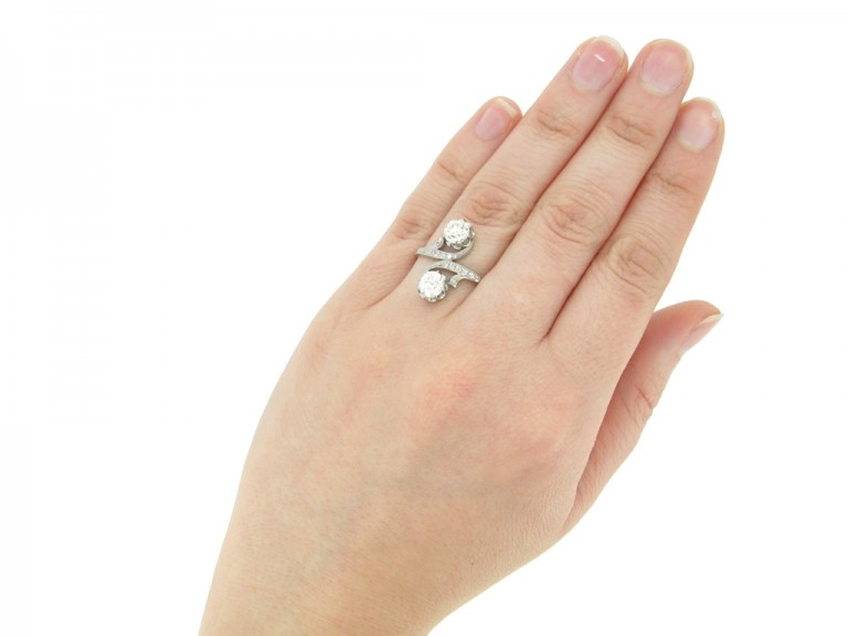 hand view Antique diamond two stone cross over engagement ring, circa 1910.