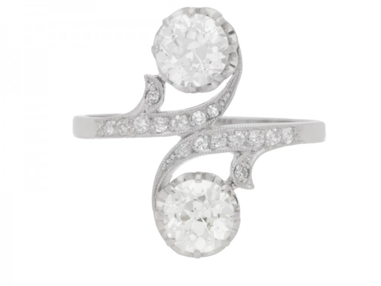 front view Antique diamond two stone cross over engagement ring, circa 1910.