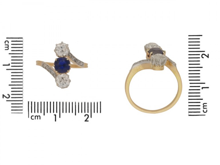 size view Antique sapphire and diamond three stone cross over engagement ring, circa 1905.