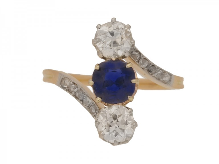 front view Antique sapphire and diamond three stone cross over engagement ring, circa 1905.