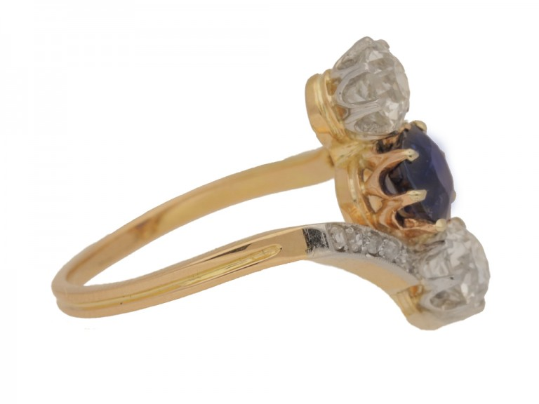 side view Antique sapphire and diamond three stone cross over engagement ring, circa 1905.