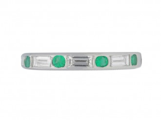 front view Oscar Heyman Brothers emerald and diamond eternity ring, circa 1950.