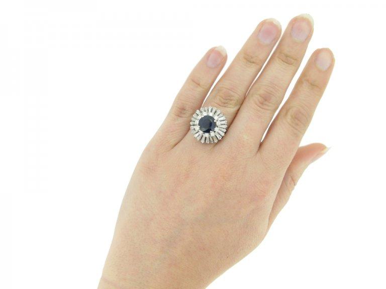 hand view Vintage sapphire and diamond ballerina coronet cluster ring, circa 1970.