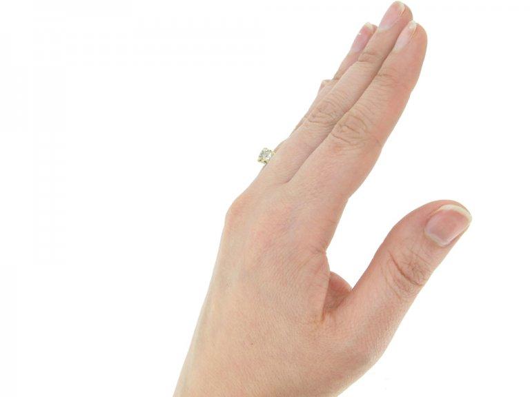 hand view Antique diamond five stone ring, circa 1900.