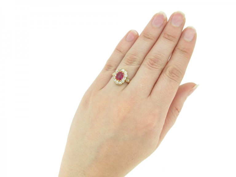 hand view Burmese ruby and diamond cluster ring, circa 1890.