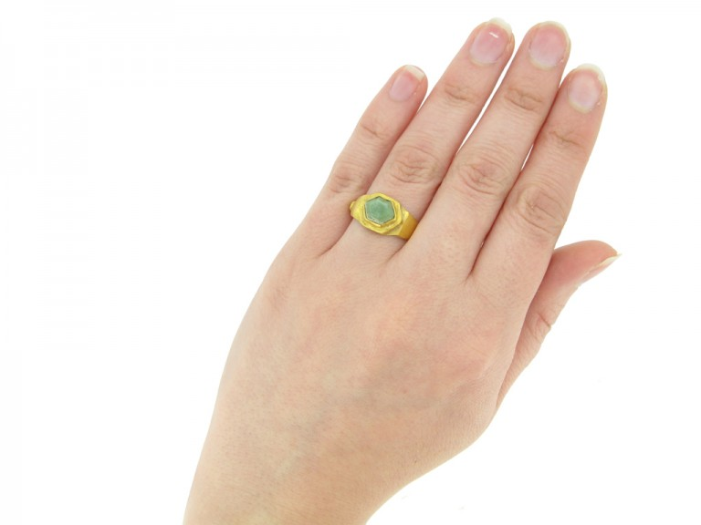hand view Ancient Roman ring set with green agate, circa 2nd 4th century AD.