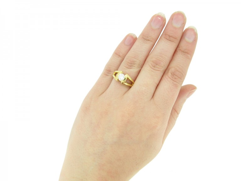 hand view Solitaire diamond ring by Mellerio, French, circa 1970.