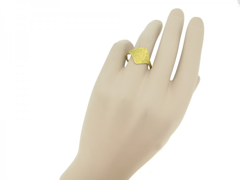 hand view Gold Viking stamped ring, circa 9th 11th century.
