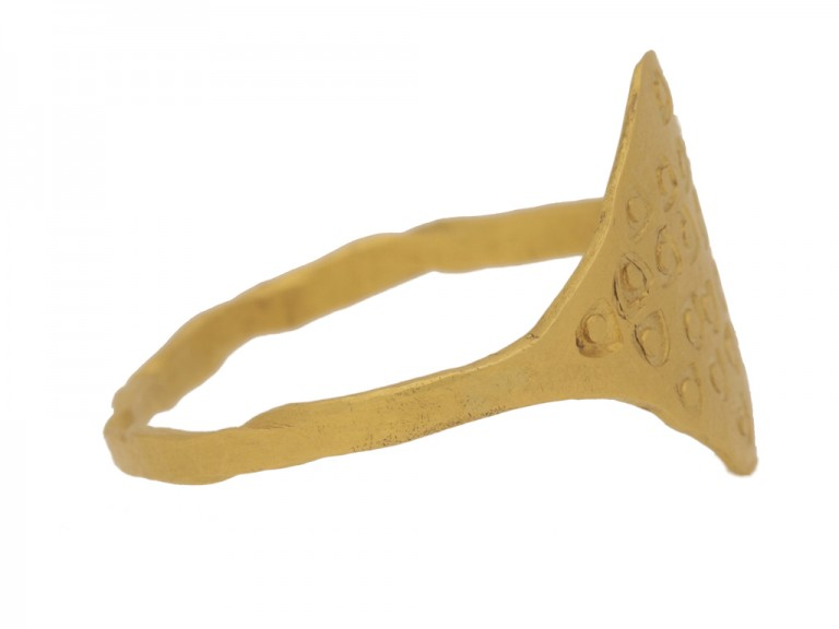 side view Gold Viking stamped ring, circa 9th 11th century.