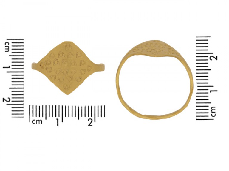size view Gold Viking stamped ring, circa 9th 11th century.