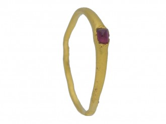 side view Medieval amethyst Bishop's stirrup ring, circa 13th century.