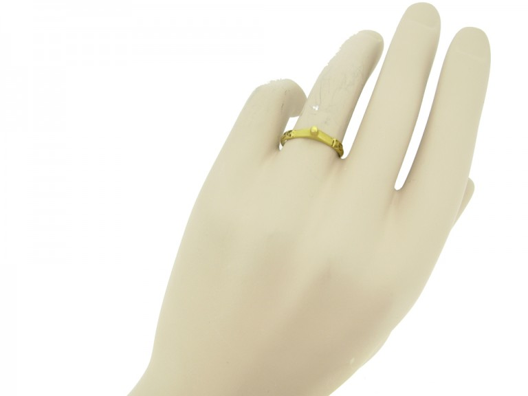 hand view Medieval gold fede betrothal ring, circa 13th century.