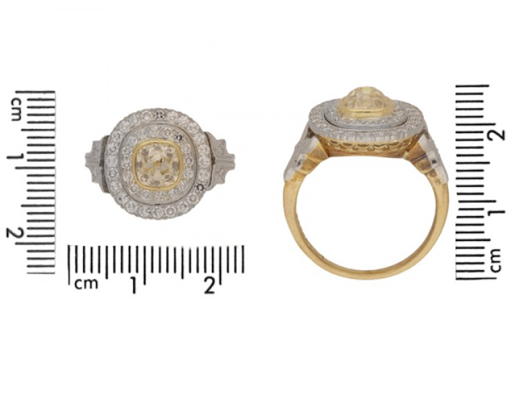 SIZ EVIEW Cushion shape old mine diamond cluster ring, circa 1910.