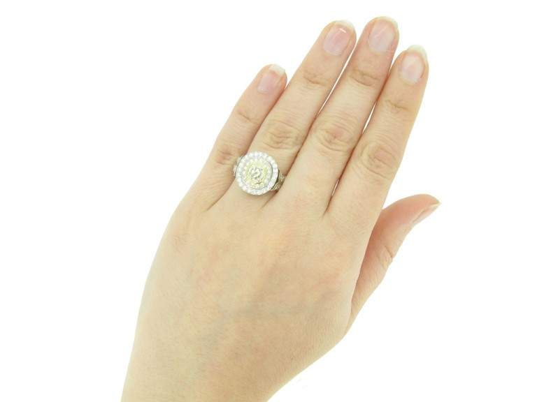 HAND VIEW Cushion shape old mine diamond cluster ring, circa 1910.