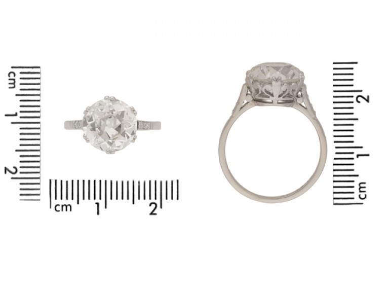 size view vSolitaire old cut diamond ring with diamond set shoulders, circa 1920.