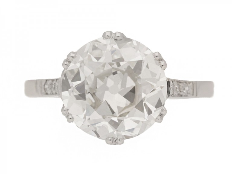 front view Solitaire old cut diamond ring with diamond set shoulders, circa 1920.