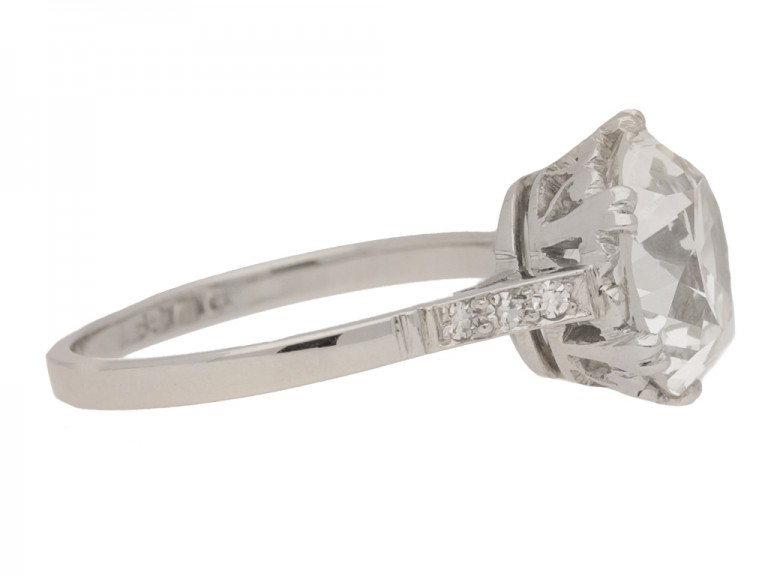 side view Solitaire old cut diamond ring with diamond set shoulders, circa 1920.