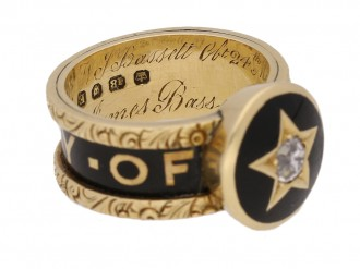 side view Victorian diamond set family memorial ring, circa 1880.