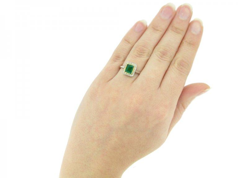 hand view  Emerald and diamond cluster ring, circa 1915. berganza hatton garden