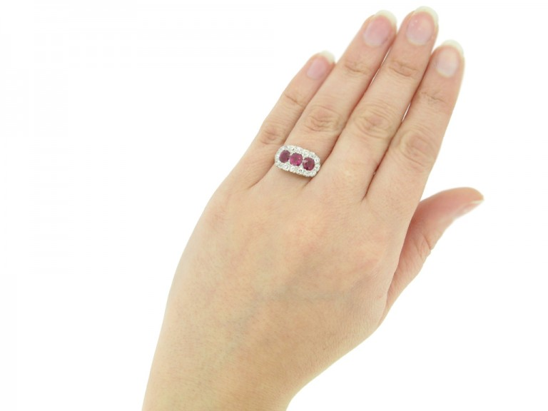 hand view Edwardian ruby triple cluster ring, English circa 1910. berganza hatton garden
