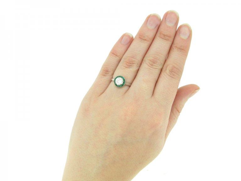hand view Diamond and emerald target ring, French, circa 1950. berganza hatton garden