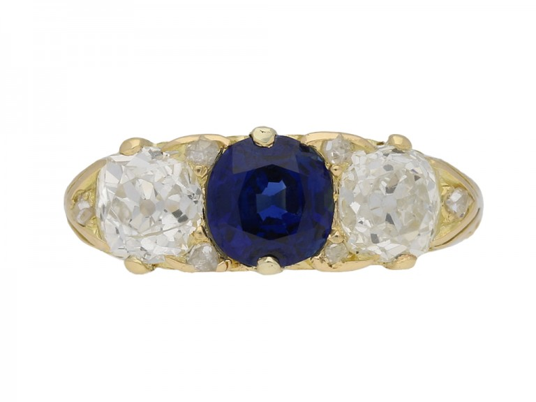 front view Antique carved sapphire and diamond three stone ring, circa 1900. berganza hatton garden