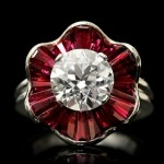 Oscar Heyman Brothers diamond and ruby cluster ring, American, circa 1970.
