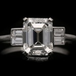 Art Deco emerald-cut diamond flanked solitaire, English, circa 1930.