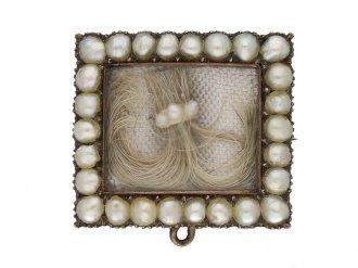 front view Georgian pearl hair brooch with locket back opening.circa 1770 berganza hatton garden