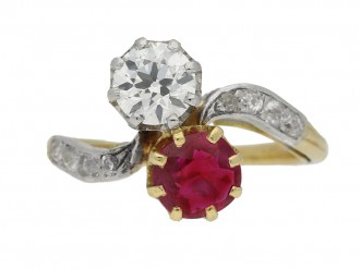 front view Ruby and diamond cross over ring, circa 1910.