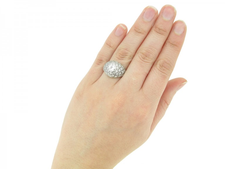 hand view Bombé diamond cluster ring, circa 1930.