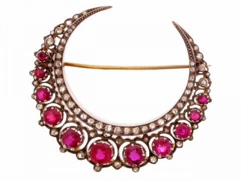 front view A Victorian ruby and diamond crescent brooch, English, circa 1885.
