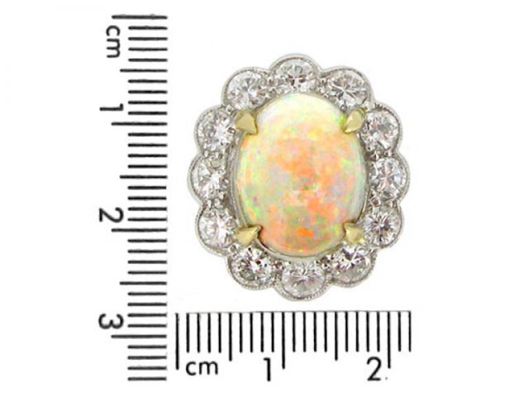sizwe view Opal and diamond coronet cluster ring, circa 1950.