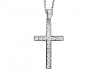 A diamond set cross mounted in eighteen carat white gold.