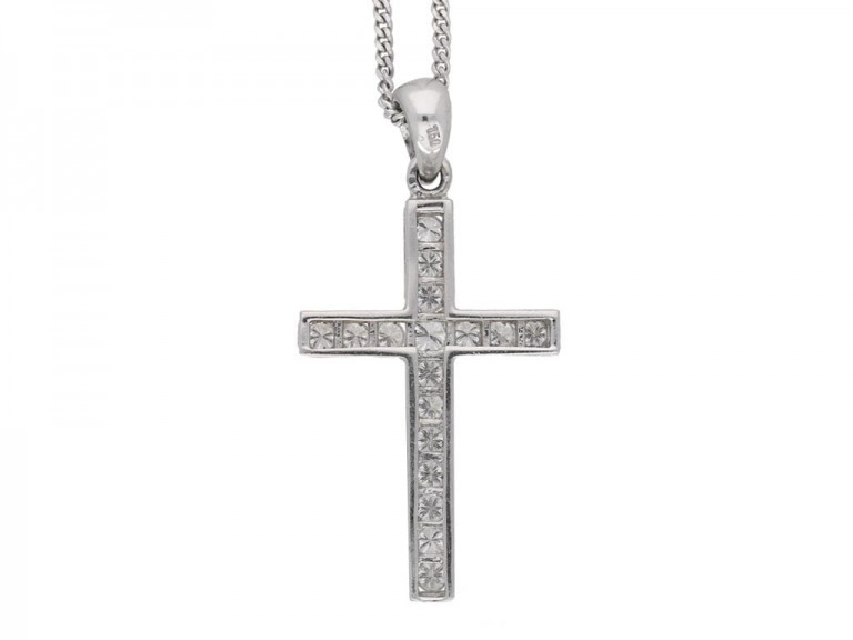A diamond set cross mounted in eighteen carat white gold.