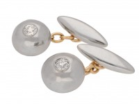 front view Diamond set cufflinks in platinum and gold, circa 1920.