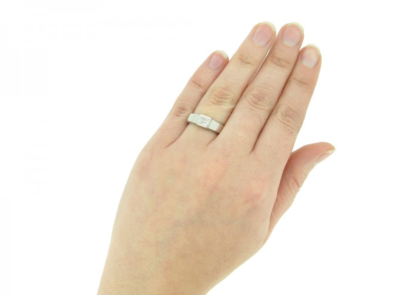 A diamond solitaire ring mounted in platinum.